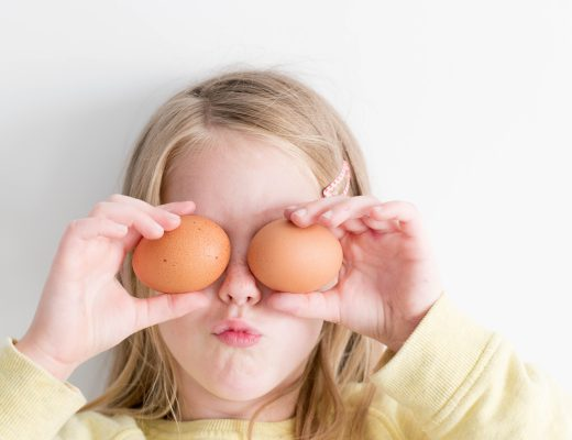 Girl playing with eggs