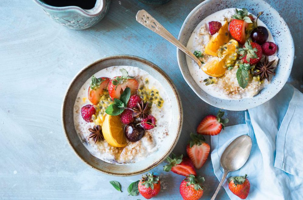 A bowl of porridge with fruit