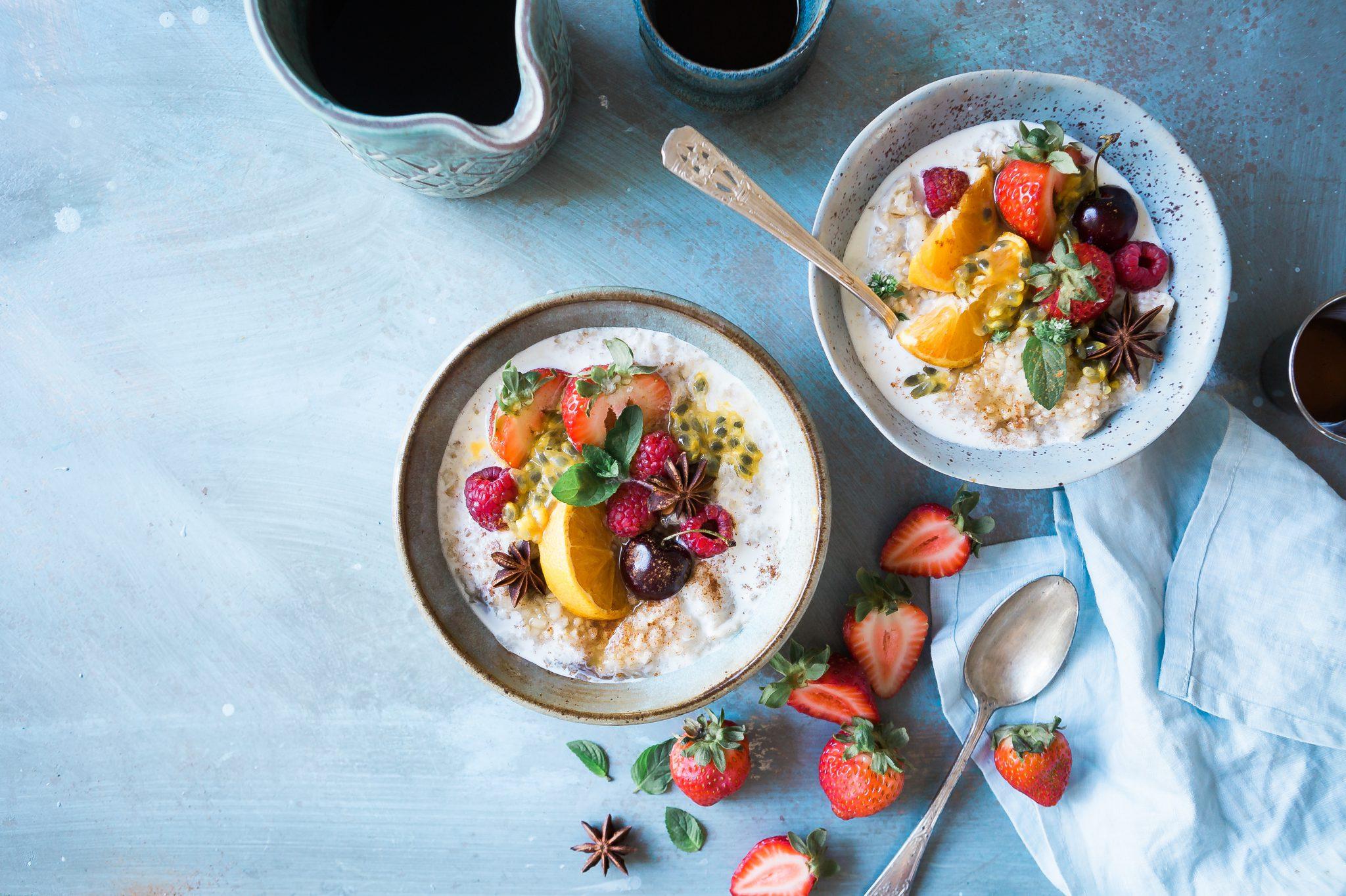 A bowl of porridge with fruit