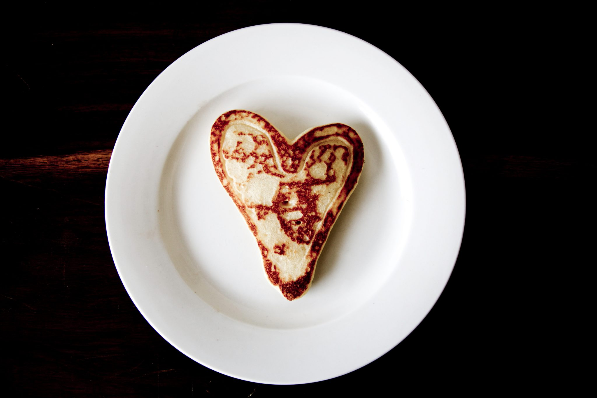 heart shaped bread on white plate